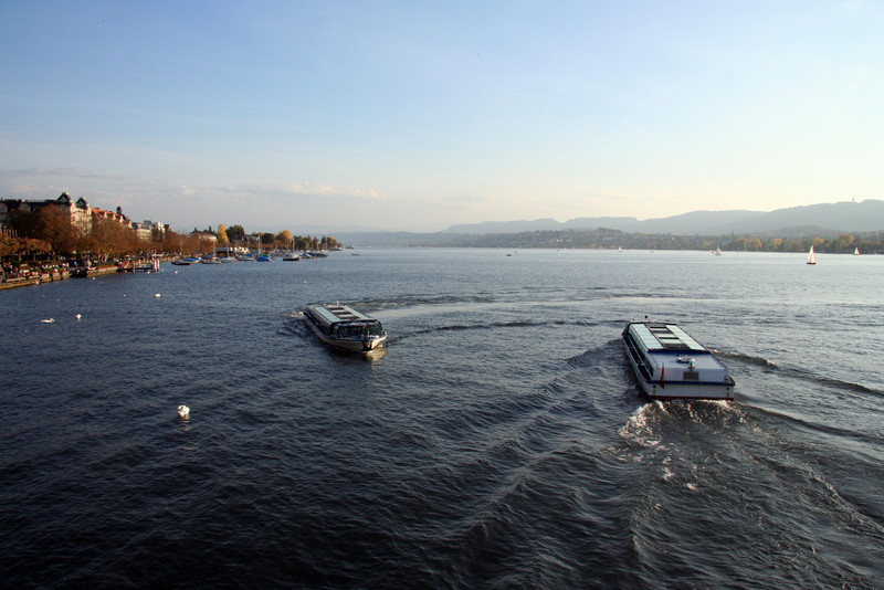 Zürichsee, or Lake Zurich. Tour boats pass each other on their way into and out of the canal.