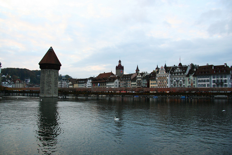 The Kapellbrücke (Chapel Bridge) and stone Wasserturm (water tower) in Lucerne.