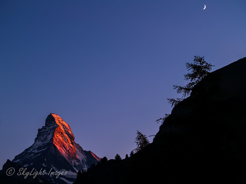 Sunset on the Face with rising moon