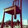 'Broken Chair' - This giant chair with a broken leg stands across the street from the Palace of Nations, in Geneva. It symbolises opposition to land mines and cluster bombs, and acts as a reminder to politicians and others visiting Geneva.