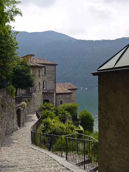 Morcote, on Lake Lugano, filled with quaint cobblestone passages and stone houses along the water - Switzerland