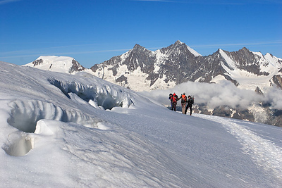 Climbers on Weissmies, Mischabel group behind