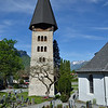 Church bell tower and cemetery in Meiringen.<br /> The foundations date to 11th century and have been buried deeply by deposits from numerous floods.