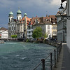 Bank of the Reuss River in Lucerne with Jesuits' Church and several of the old town buildings.<br /> May 15, 2012