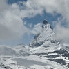 Shot from the window of the cog railway on the way back to Zermat, the Matterhorn shows through the clouds.