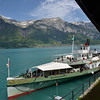 Paddlewheel steamboat on Lake Brienz provides transportation to villages around the lake.<br /> View across lake to the town of Brienz.<br /> Sunday May 20, 2012