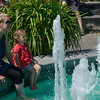 A Mom and her daughter enjoy a fountain in the gardens on Mainau Island.