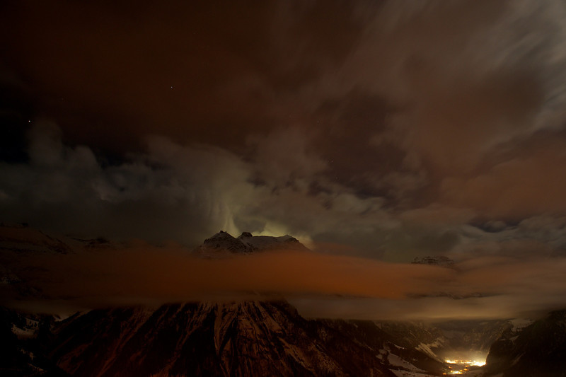 MOUNT DOOM!  Actually a midnight photo of the Galrus Alps from Braunwald.  13 second exposure with the moon behind the ridgeline and sodium lights of Braunwald uplighting the cloud in the foreground.