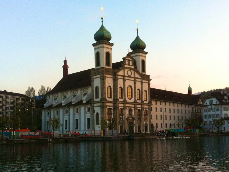 A church in Lucerne is lit by the setting sun.