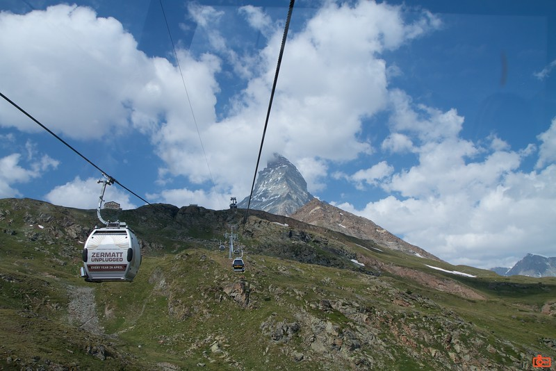 The lifts to Klien Matterhorn, with the towering peak of the Matterhorn in the distance.<br /> IMG_9580