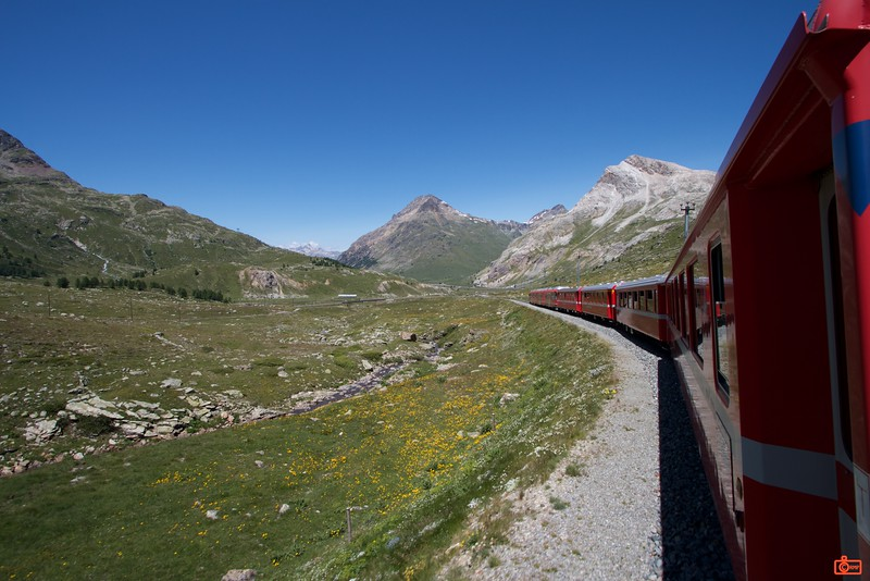 The Bernina Express is one of the only World Heritage Sites that is a railway. It climbs the Bernina Pass at 2,253 metres. The last 2 cars of the train are open for better sightseeing.<br /> IMG_9876
