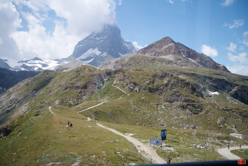 Hikers on a well-marked trail with the tooth of the Matterhorn rising in the background.<br /> IMG_9677