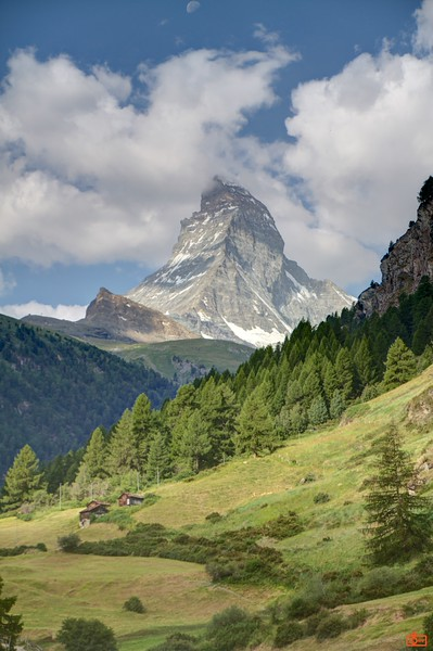 The Matterhorn is a pyramidal mountain in the Alps reaching a height of 4,478 metres (14,692ft). Its very steep sides prevent snow accumulation and make for a very difficult route to the summit.<br /> _MG_9563_HDR