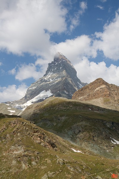 The Matterhorn is a pyramidal mountain in the Alps reaching a height of 4,478 metres (14,692ft). Its very steep sides prevent snow accumulation and make for a very difficult route to the summit.<br /> IMG_9581