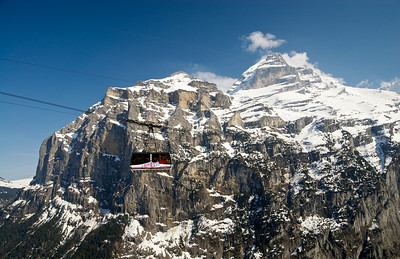 The Schilthorn cable car, with Jungrau in the background, taken on the walk between Gimmelwald and Mürren.