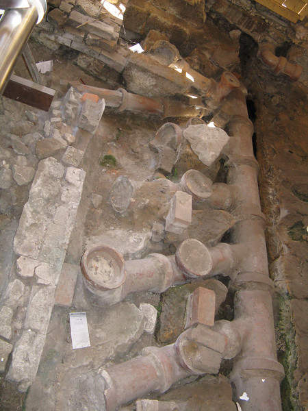 Inside the old building was some excavated pipes under the floor.