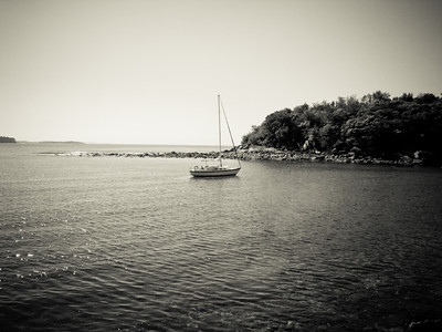 A sailboat chilling in Manly Cove. I thought this would look better as a B&W photo - - I tend to like it.