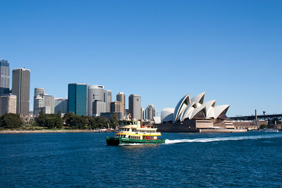 A ferry passing by the Sydney Opera House -- taken while on a different ferry headed to Circular Quay.