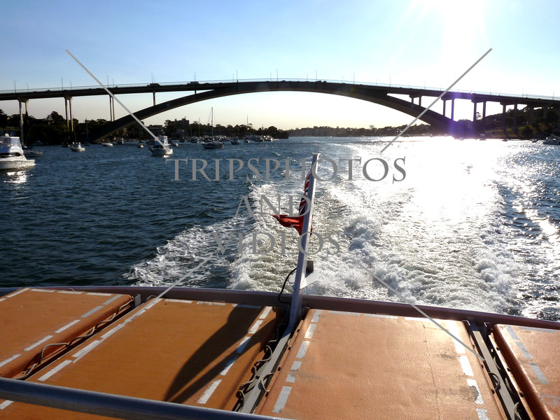 Ferry boat passed under the Gladesville bridge spanning the Parramatta river in Sydney, Australia.