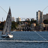 Sailboat cruising the harbour in Sydney, Australia.