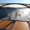 Ferry boat passed under the Gladesville bridge spanning the Parramatta river in Sydney, Australia.