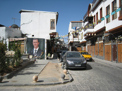 Mr al Assad watches over a street in the souq.