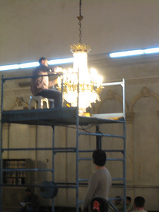 I've always wondered how they got up to change the lights on the big chandaliers and now I know!