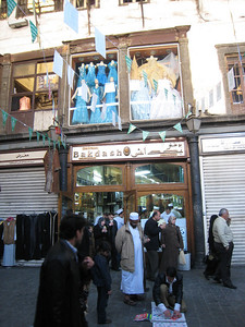 Outside Bakdash which is the most popular place in Damascus for mahlayed which is made with milk cream, pistachio and almond and served in a cone like an icecream.
