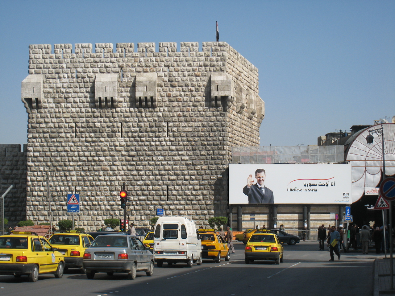 The citadel in Damascus which is just along from the Umayyed mosque.  The citadel is closed for restoration.  Beside it is a large poster of the Syrian president Basher al-Assad whose photo is everywhere and I mean everywhere!