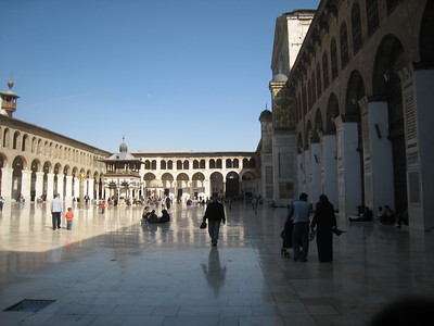 The central courtyard of the Umayyed Mosque. In the far left hand corner is a separate shrine to Hussein grandson of the Prophet (pbuh) he was the son of Ali ibn Abi Talib and Fatima  the Prophet's daughter who was killed at Kerbala in Iraq.  Tradition has it that Hussein's head is within the shrine and it is a major place of pilgrimage for Iranian Shi'ites.  When we were there, people were in tears and the atmosphere within Hussein's shrine was very emotional.