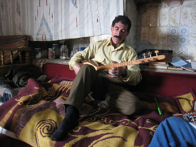 "Yasine playing the ""Kurdish guitar"" the saz."