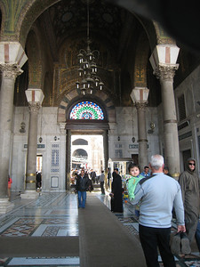 Looking back at the entrance to the Umayyed Mosque.  The mosque site has been in use as a place of worship for nearly 3,000 years.  A church was built here in the 4th century on the site of earlier pagan temples and after the Muslim conquest of Syria the building was shared for decades by Christians and Muslims.  Around 700AD the church was demolished and the present mosque built in its place.