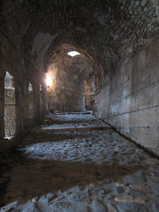 The entrance to Krak de Chevaliers.  The long stairs were constructed so horses could get up the ramp.  The holes in the roof are not only to let in light, but also in times of battle were used to drop hot oil onto attackers.