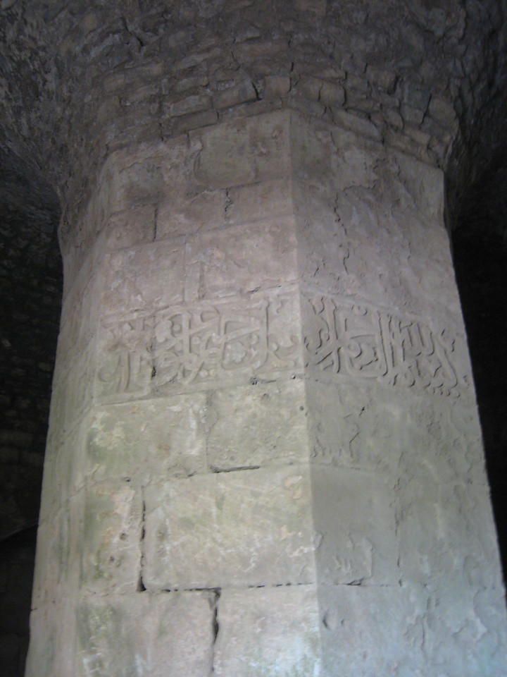 """Inside the southwest tower of the castle.  The inscription on the column is in Arabic giving the full title of Beybars the Mamluk sultan who took over the castle in 1271. The full title of Beybers was """"The Manifest King, Pillar of the World and the Faith, Father of the Victory."""""""