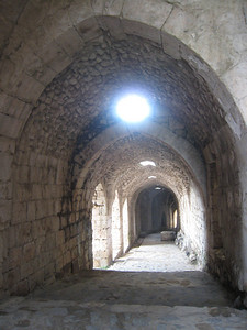 Looking back down the entrance ramp.  Once its military need passed the castle was neglected and local villagers moved in.  They were relocated to the nearby village in 1934 and restoration of the castle began by the French.  The castle was given to Syria as compensation for the damage done to Damascus during the French bombardment in 1945.