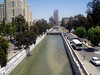 Damascus street scene -- from pedestrian bridge overlooking Barada river canal