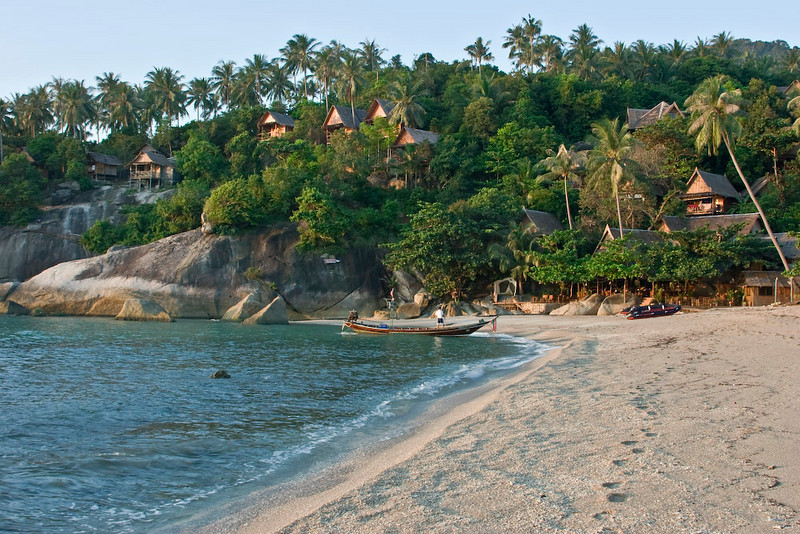 Beach scene with the Sanctuary Resort in the background.  It is located on Koh Phangan which is next to Koh Samui.