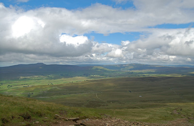 Ingleborough (left,flat top) and Whernside (broad ridge just right of centre in the distance), seen from Pen-y-ghent. Our path wasn't the bright line in the centre, but the fainter (and boggier) route to the right.