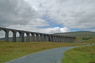 Ribblehead Viaduct and Whernside. The summit is probably less than 2 miles away at this point, but to prevent erosion on the direct route walkers are now directed on a big loop to the east (right), which is at least twice as far.