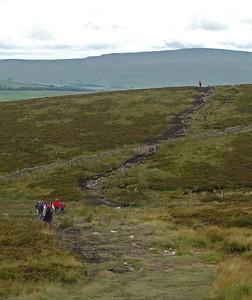 Heading towards Whernside on the heavily eroded path