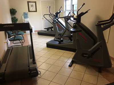 Small fitness center. 1 treadmill, 1 stationary bike and 2 elipitcal trainers.