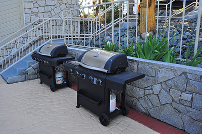 outdoor grills by the clubhouse pool