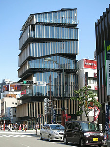 Asakusa Cultural Info Center by Kengo Kuma on Kaminarimon. The entrance to the shrine is behind us.