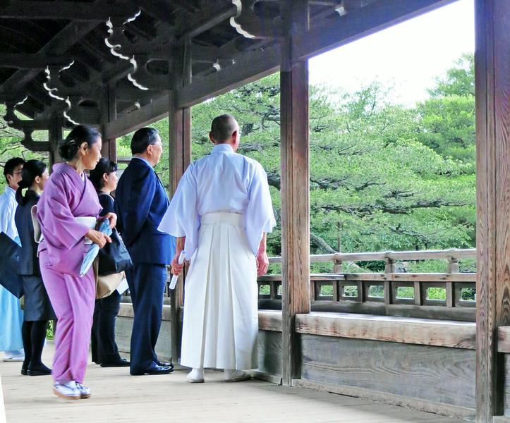Zen Buddhist monk escorts VIPs