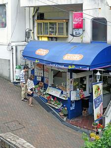 A shop along the narrow uphill street