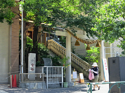 Torii. Gate (with three bamboo-rope bells) marks neighborhood shrine.