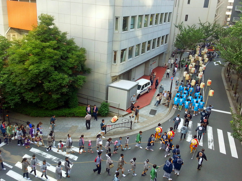 The biennial Sanno Matsuri parade, turning the corner and heading up the hill to the shrine.