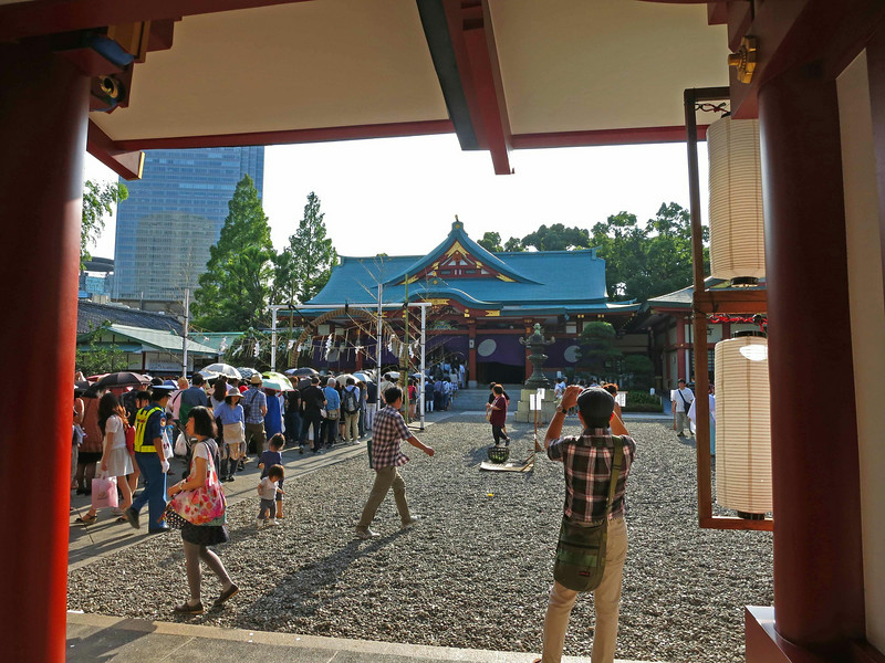 In the courtyard, people queue to enter the shrine