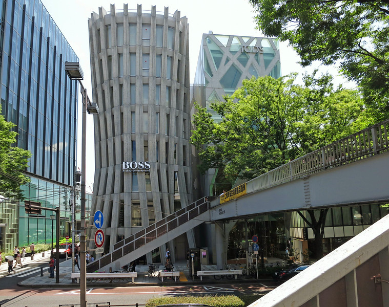 Tod's building (right), by Toyo Ito, 2004. The structural system mimics trees. Toyo Ito is the 2013 Pritzker Architecture Prize Laureate. The BOSS building, by Norihiko Dan, 2013, tries to mimic a tree trunk.