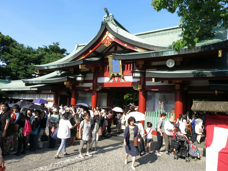 In the courtyard, people queue to enter the shrine (out of picture to the left)